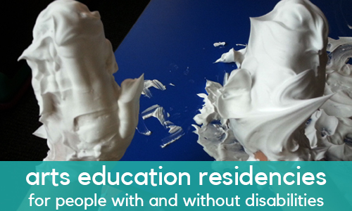 """Arts education residencies for people with and without disabilities"" - A pair of hands covered in shaving cream against a blue background"