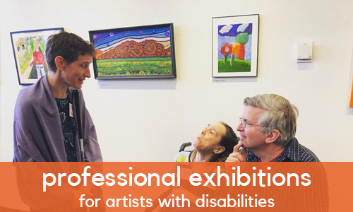 Three people gathered in a gallery, engaged in conversation. An orange banner with white text reads: professional exhibitions for artists with disabilities